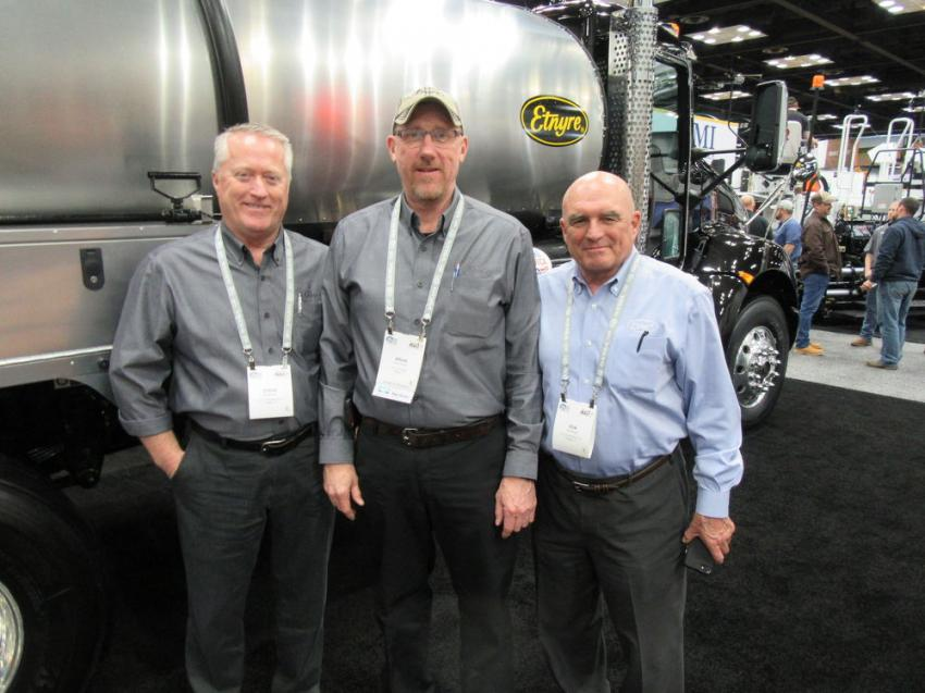 (L-R): E.D. Etnyre & Company's Steve Carr, Brian Horner and Don Etnyre had several examples of the company's lineup of equipment for the asphalt roadbuilding industry.