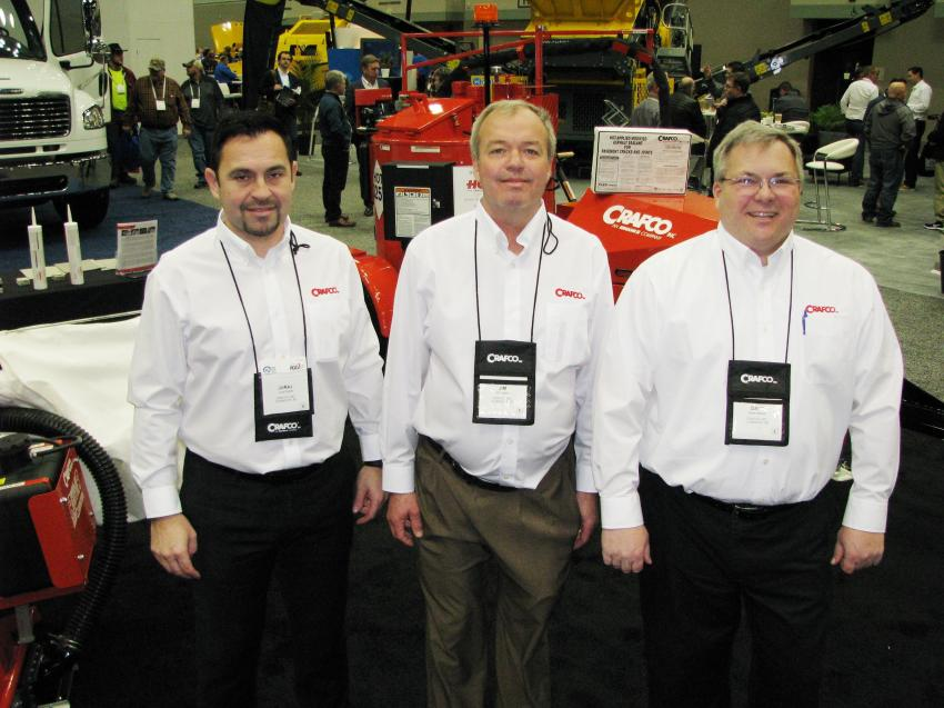 Out promoting their machines and new HP Concrete, a concrete cold patch, (L-R) are Juraj Rypak, Jim Lippert and Dave Keener of Crafco Inc., Chandler, Ariz.