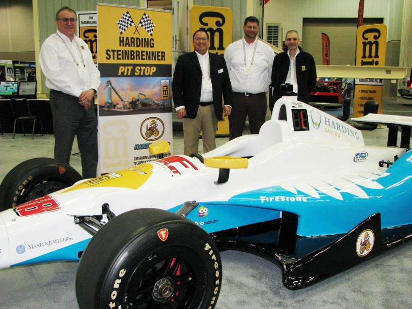 The Harding Racing Indy car was a big draw at the CMI Roadbuilding exhibit, giving (L-R) Russ Sciville, Trevor Thielbar, Michael Knight and Kevin Smith the opportunity to discuss their product line with visitors.