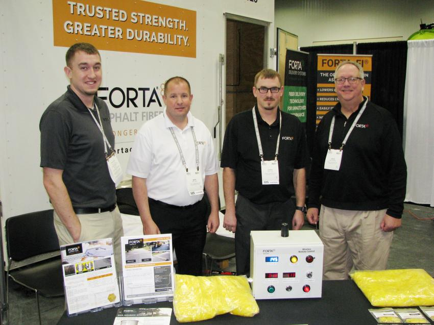 (L-R): Garrett Lovett, Mike Jenkins, Chris Lovett and Dave Huddleston of FORTA Corp., Grove City, Pa., displayed their asphalt reinforcing fibers and new wireless remote-control fiber-feeding machines.