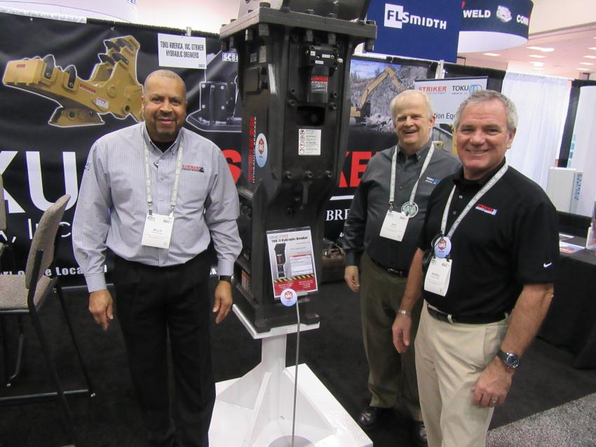 (L-R): At the Toku America booth, Willie Studway, Bud Moore and Russell Walton were ready to discuss the company's line of Striker hydraulic breakers.