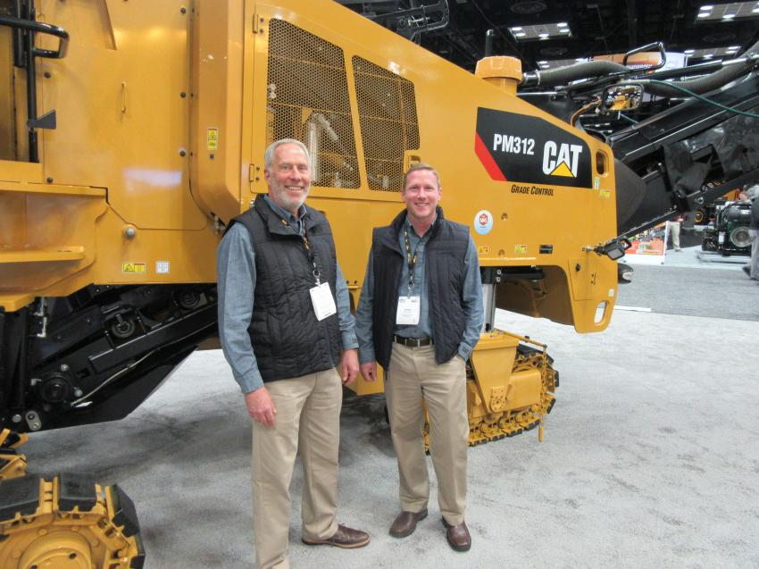 At the Caterpillar equipment display, Randy Dobson (L) and Chris Barnard were ready to discuss the capabilities of this Cat PM312 cold planer as well as a host of other Caterpillar and Weiler paving equipment.