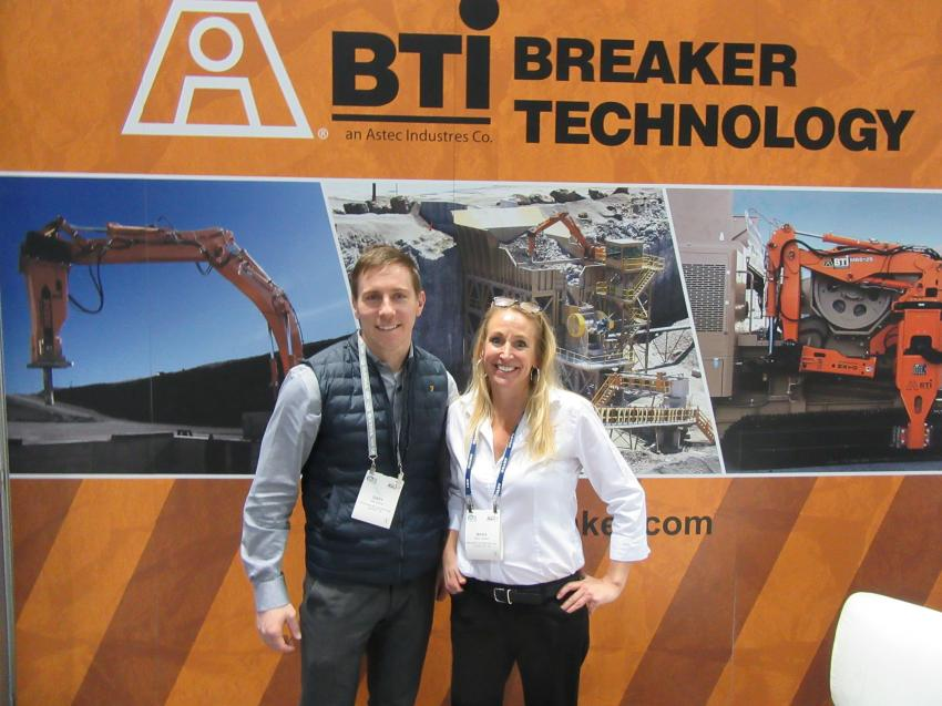 At the Breaker Technology Incorporated booth, Gary Guthrie (L) of Lippman-Milwaukee spoke with Maria Cargould of Breaker Technology Inc.