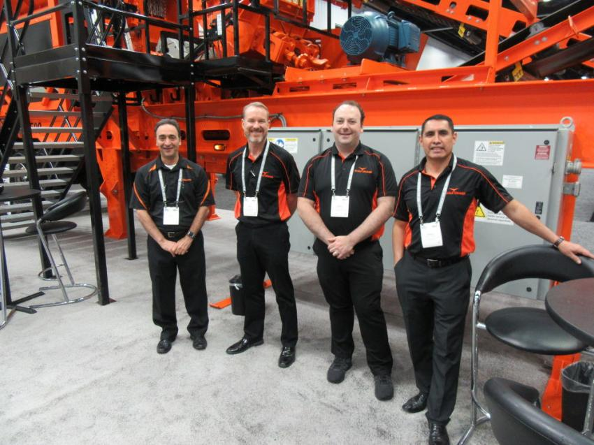 (L-R) Eagle Crusher Company's Greg Spina, Pat Meara, Daniel Friedman and Sergio Gonzalez attracted a good deal of attention with the first show display of the company's recently launched Stealth 500 portable crusher plant.