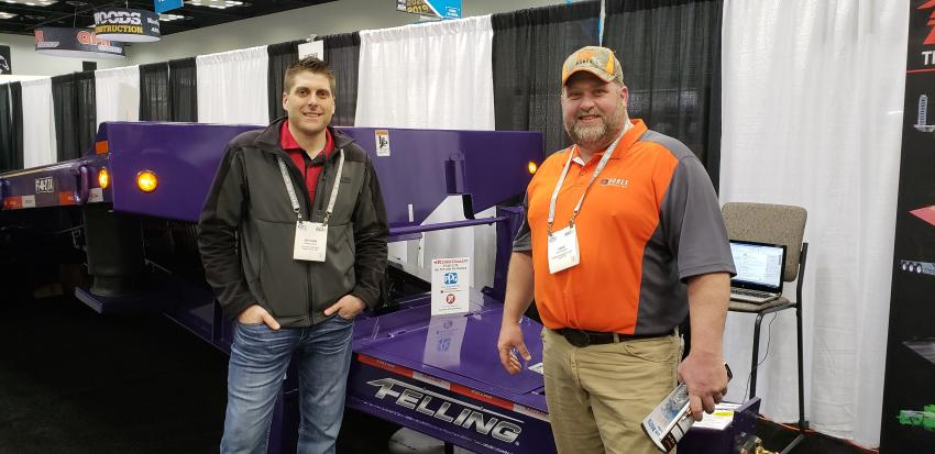 Nathan Uphus (L), sales manager at Felling Trailers,  Sauk Centre, Minn., with Jake Anderson of Durex Products, Luck, Wis., wonders if the purple FT-40-2 TA comes in Packer green and yellow.