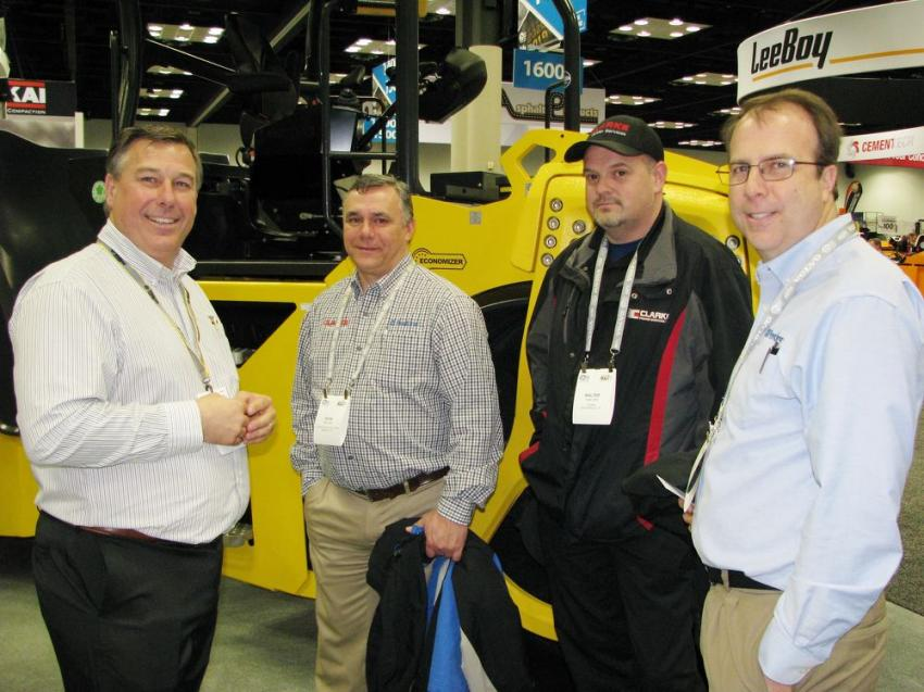(L-R): Bomag Americas' Jamie Winkler discusses the Bomag product line with Kevin Reed, Clarke Power Services, Smyrna, Tenn.; Walter Elliott, Clarke Power Services, Martinsville, Ind.; and David Stahlman, Clarke Powered Solutions, Mooresville, N.C.