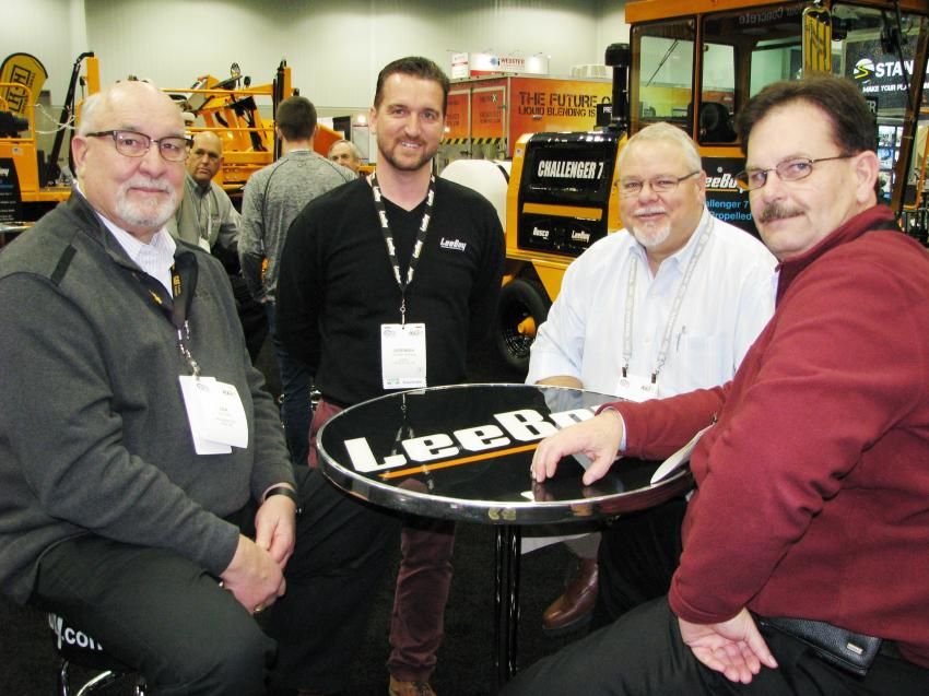 Dealers meeting with their manufacturer rep Jeremiah Reinhardt (second from L) in the LeeBoy exhibit area (L-R) include Len Evans, Michigan Cat, Novi, Mich.; Phil Ireland, Ring Power Cat., St. Augustine, Fla.; and Jim Damron, Michigan Cat.