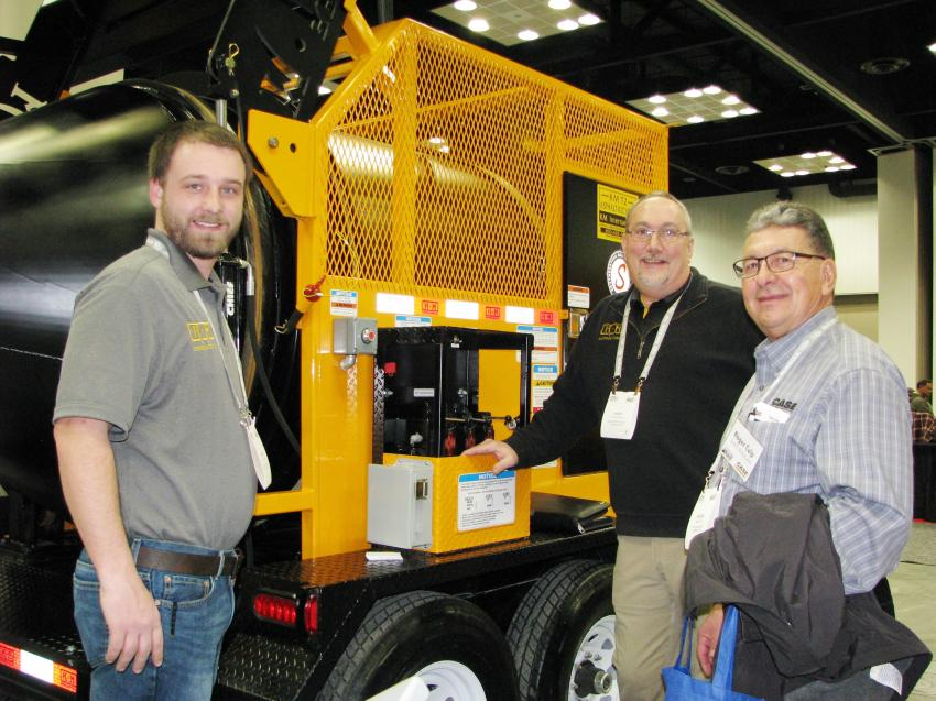 (L-R): KM International's Jessie Gregory and Kurt Schwartz talk with Roger Culp of RPM Machinery, Lebanon, Ind., about their product line.