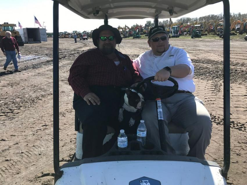 Josh (L) and Tom Schott of Sebring, Fla, are enjoying the Yoder & Frey auction with their dog, Diesel.