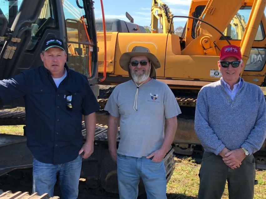 Inspecting a late-model Volvo excavator (L-R) are Bill Dunbar, president of Dunbar Construction, Littleton, Maine; Ken Moran, owner of K.T. Moran & Son in Littleton, Maine; and Albert Fitzpatrick, also of Dunbar Construction.