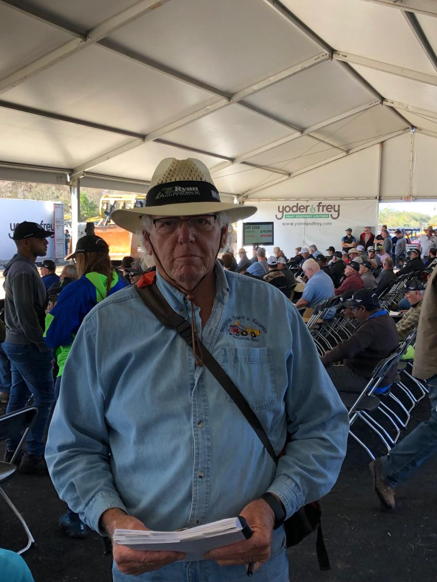 Doug Ryan of Ryan Auctions closely monitors the very strong bidding activity at this year's sale.