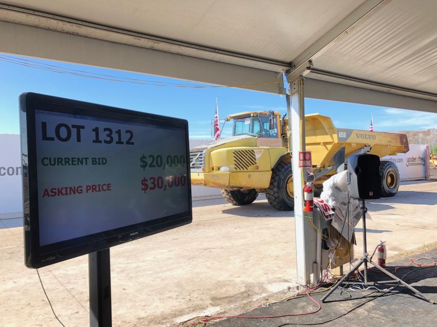 Large monitors keep bidders informed of the current bid.