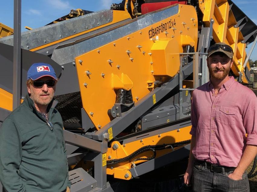 Adam Kenny (L) of Sand Science and his father, Jerry Kenny, dealers of quality aggregate products based in South Carolina, check out the wide selection of portable aggregate plants at the Yoder & Frey sale.
