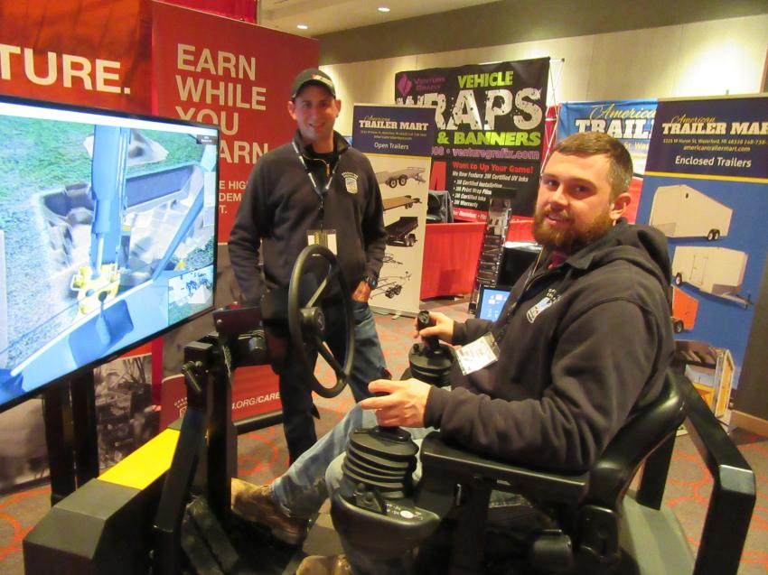 Operating Engineers Local 324 representatives Dustin Nothelfer (L) and David Swanson demonstrate a simulator used in training.