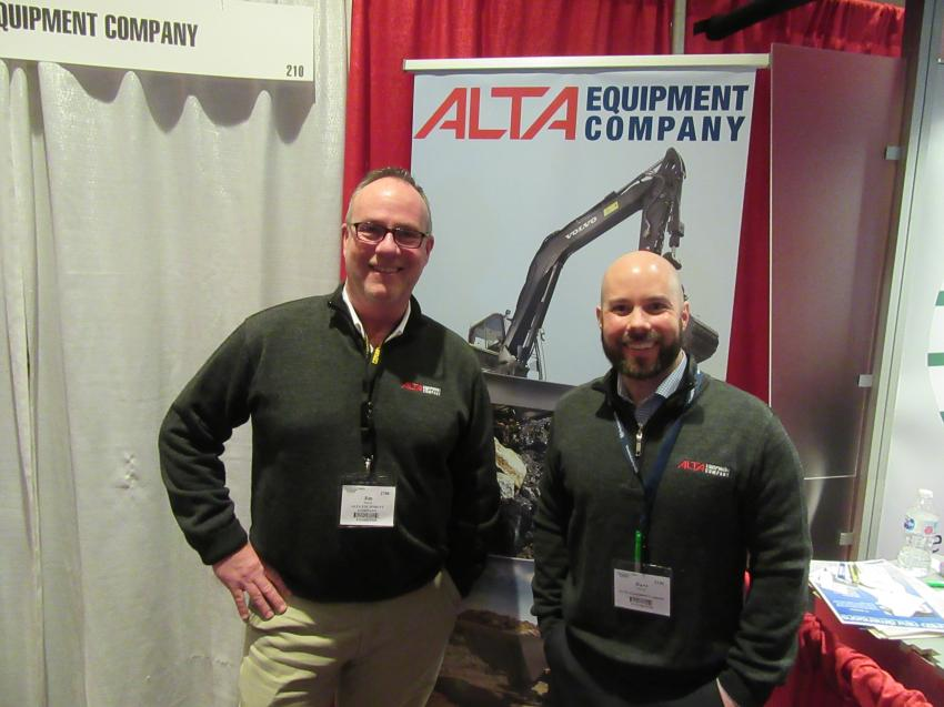 Alta Equipment Company's Jim Butler (L) and Dave Brown spoke with attendees about the dealership's Volvo and other equipment lines for sale or rent.
