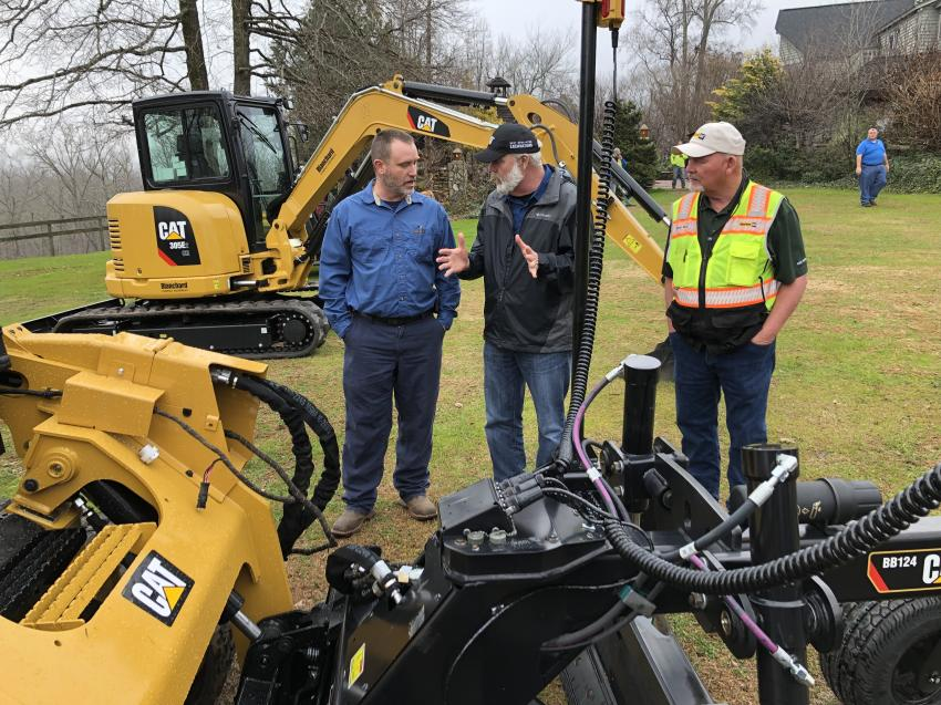 Randy Rohrer (C) of Sitech Mid Atlantic explains the finer points of the Trimble System to Travis Rollins (L) of Vulcan Materials as Tommy Moore of Blanchard Machinery looks on.