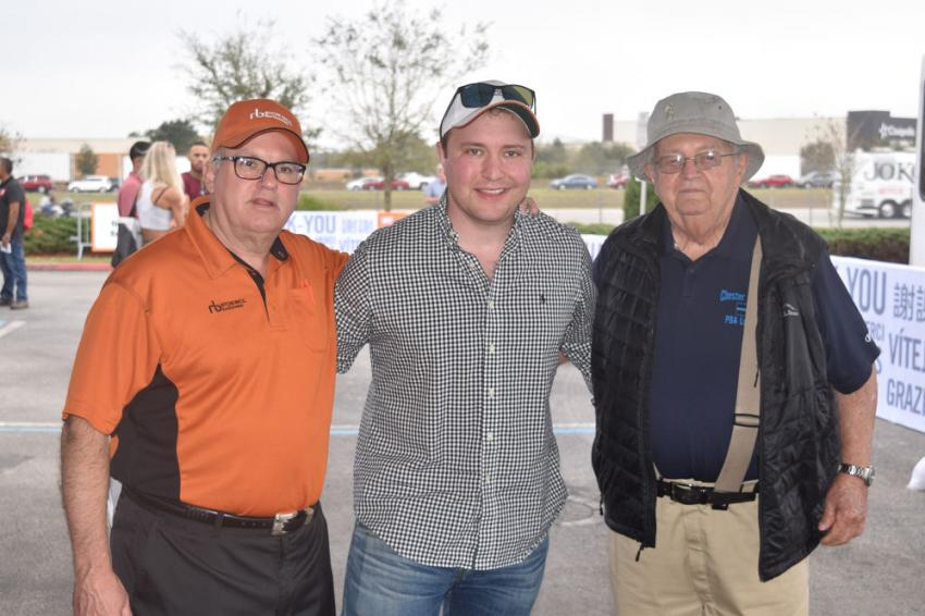 (L-R): Fred Vilsmeier, auctioneer of Ritchie Bros., stands with Dylan Hoffman, project manager, and Russ Duryea, owner, both of R&R Construction Co. Inc. of N.J.