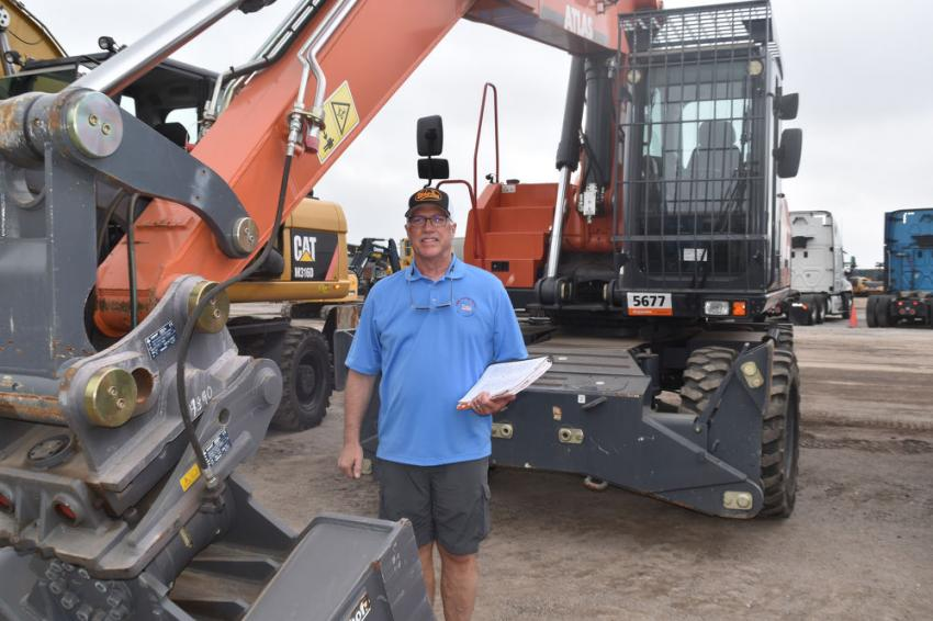 Dennis Dieffenbach, owner of Dieffenbach Equipment, Myerstown, Pa., is looking at a few wheeled excavators