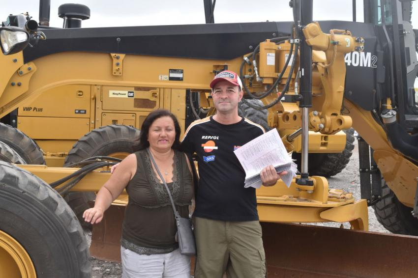 Theresa and Anthony Gonzales, owners of Worldwise Corp. in San Antonio, Texas, were looking at a Caterpillar motorgrader.