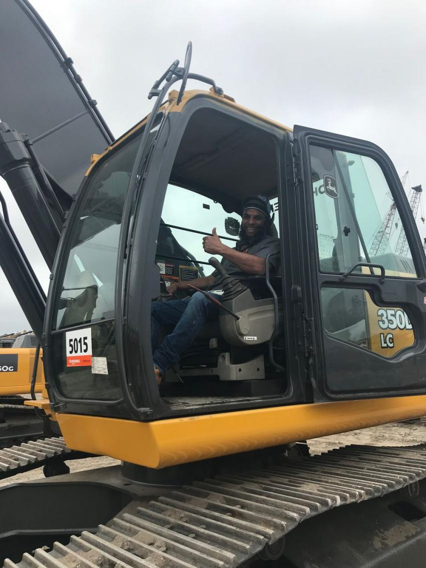 Jason Lee of Coast to Coast Logistics, Cleveland, Ohio, likes the operating cab on a John Deere 350 hydraulic excavator.