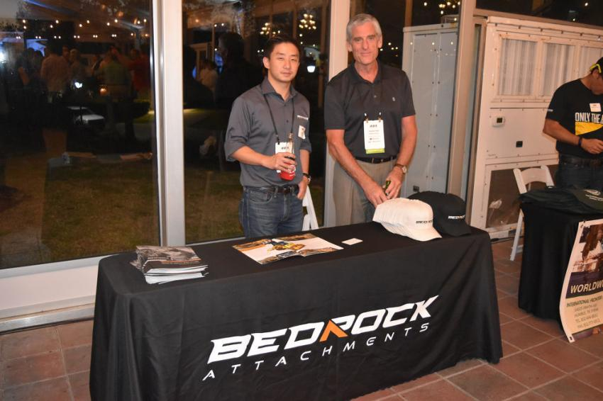 Jack Yao, managing director of Bedrock Machinery, and Daniel Hall, president of the NEBB Institute, inform IEDA members of new products.