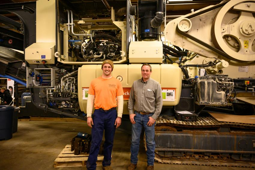 Mike Gualazzi (L) of Essex, Conn., of Cherry Hill Construction in Branford, Conn., and Tony Moura of Winsted, Conn., a seven-year outside sales associate of Whitney and Son, stand in front of the Lokotrack LT 120 mobile jaw crushing plant. This is Gualazzi's first year attending Crusher School.