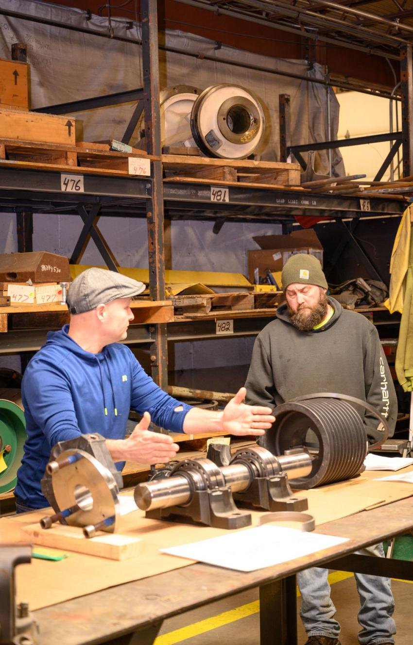 Jamie Zisk gives a hands-on lesson with a variety of parts on display in the stockroom.