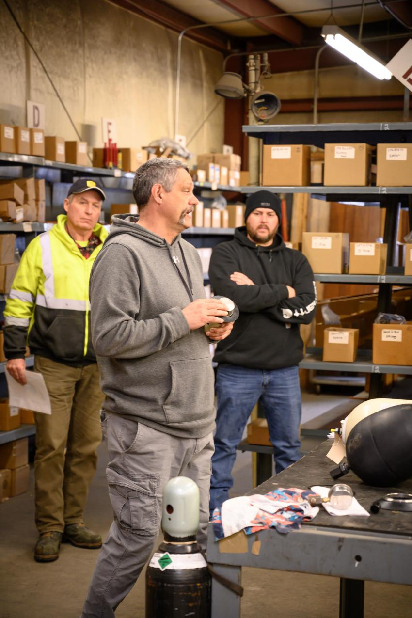 Dave Wentworth of Whitney and Son uses a variety of part and visual aids to explain the impact that a blocked valve could potentially have on a machine functioning properly.