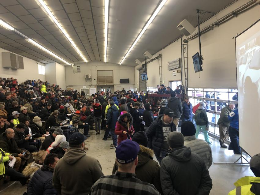The auction was conducted inside James G. Murphy's heated warehouse by slideshow and went off without a hitch.