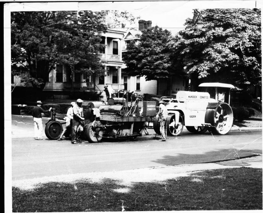 The Adnun paver with Galion three-wheel roller was a primitive asphalt paver that operated like an oversized spreader box.