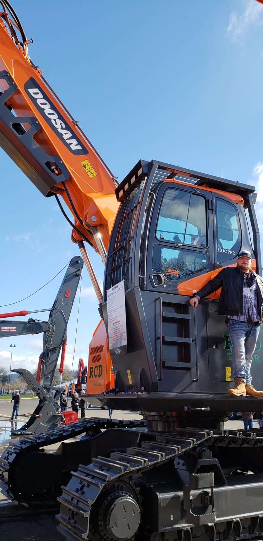 Cooper Brunoff, operations manager of Cascade Trader, Doosan's newest dealer in Idaho, rocks a pose on the Doosan excavator. In the 28-33 metric ton size class, few machines match the Doosan DX300LC. It has the horsepower to tackle larger projects. Visit Cascade Trader's new location: 53 West Boekel Rd. in Hayden, Idaho.