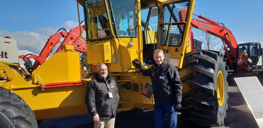Joe Azzopardi (L), Tigercat Industries, and Andy Hunter, Triad Machinery, are ready to talk about the Tigercat 635G skidder. This machine has six-wheel drive and is built for high-production logging operations.