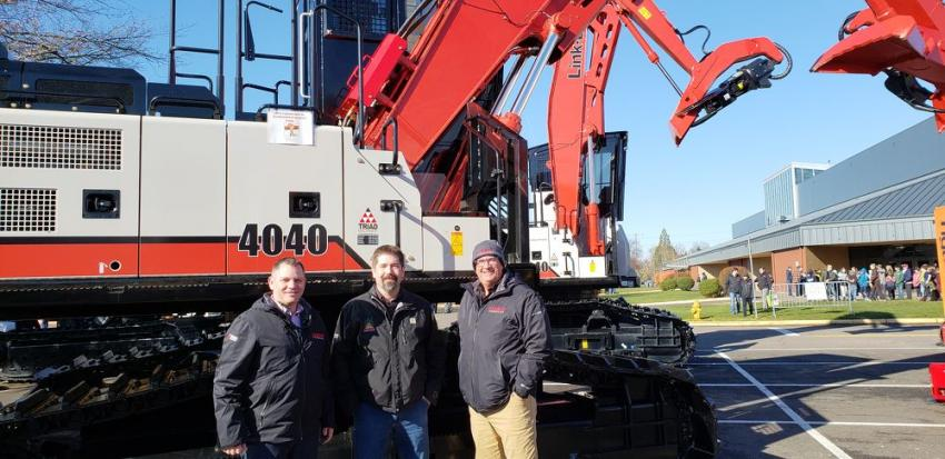 (L-R): Brian Elkins, Triad Machinery and Chad Kline and Kevin Roberts, both of Link-Belt, are with the Link-Belt 4040 processor/harvester machine.