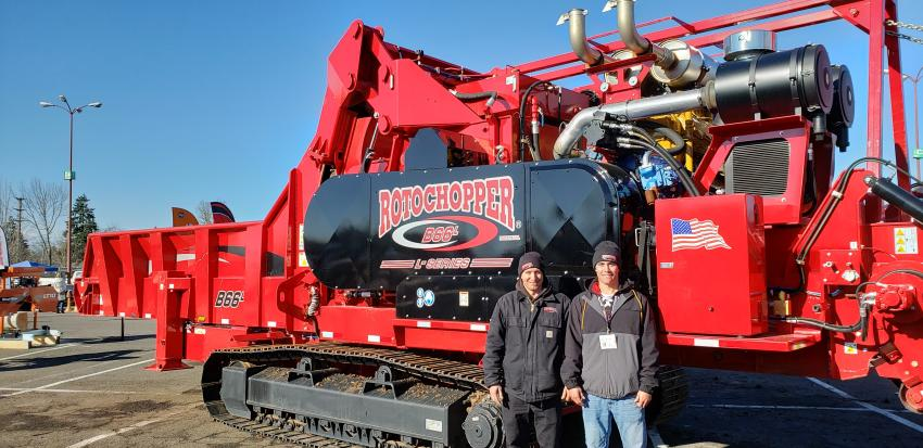 "Nick Korn (L), U.S. West coast sales manager, and CJ Cox, U.S. Pacific Northwest and Mountain West sales representative of Rotochopper, display the Rotochopper B66L L-series horizontal grinder. ""The B66L is the most advanced fiber processing system on the market, designed to meet the needs of our customers,"" said Korn."