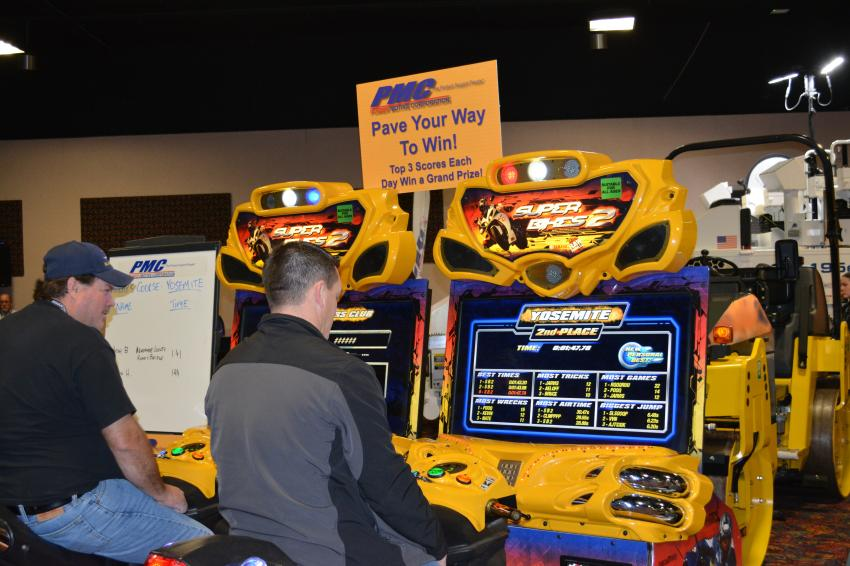 A video game contest drew crowds to the Power Motive Corporation exhibit at RMACES. Power Motive sells Roadtec paving equipment and compaction machines from Sakai.