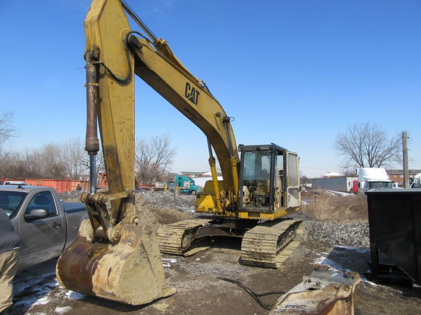 Construction equipment up for bid at the auction included a Cat 320L excavator.