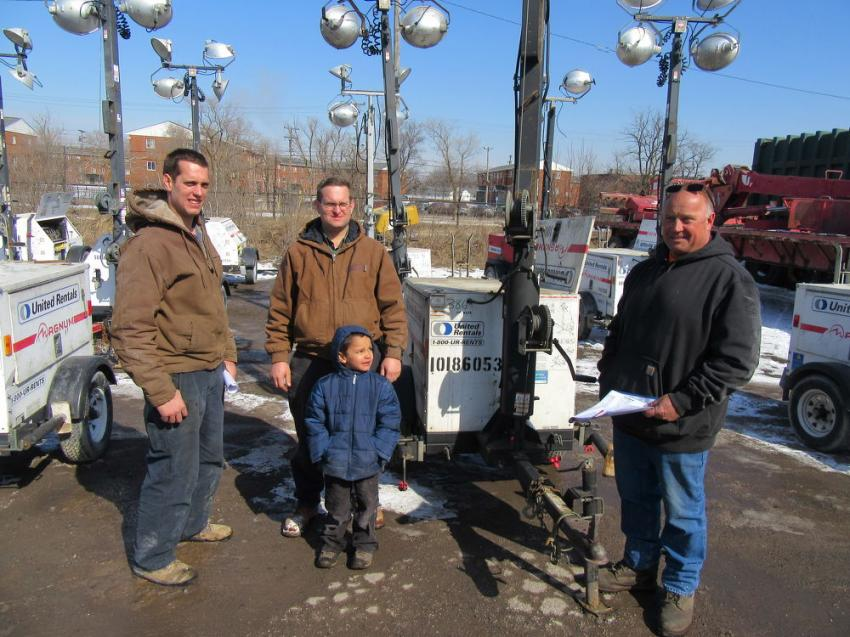 (L-R): Nevin and Dean Steiner (with Dean's son Shawn) of Steiner's Equipment joined Rich Sereday of Sereday Trucking & Demolition in reviewing light towers at the auction.