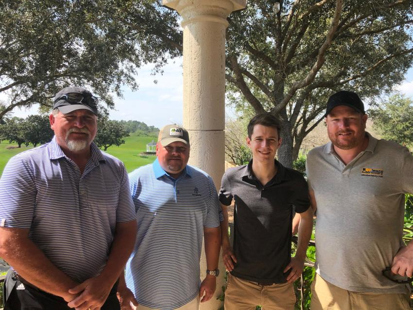 (L-R) are Bill Bunting of Cimaron Equipment Co., Tulsa, Okla.; Kenneth Tysinger of May Heavy Equipment, Lexington, N.C.; Philipp Bosl from Munich, Germany; and Eric Willering of Wilco Machinery, Amsterdam, Holland.