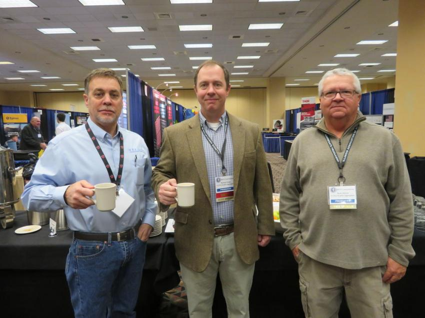 (L-R): Clyde Robison of Finkbiner Equipment Co. enjoys a hot beverage in the company of Michael Nolan and Kort Alcorn, both of VCNA Prairie Aggregates.