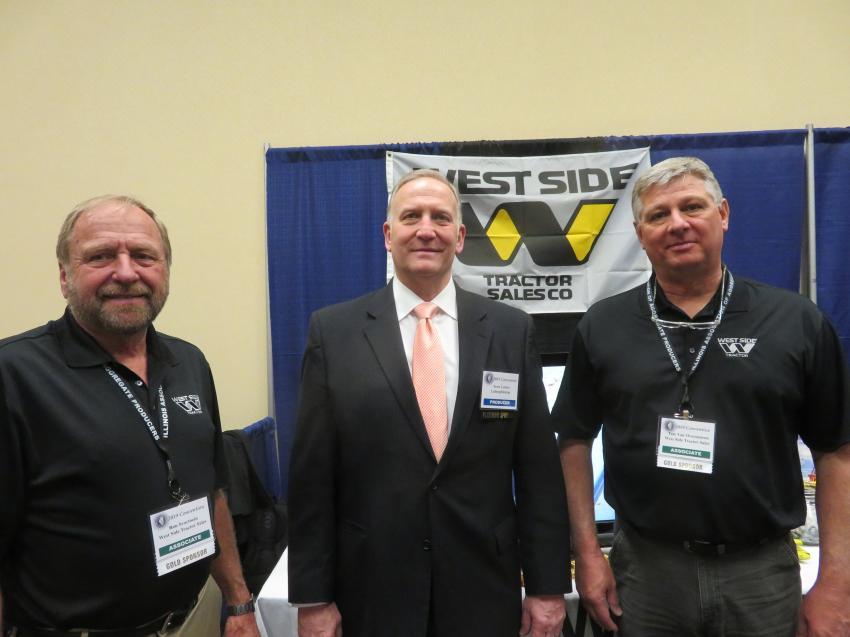 Ron Svartoein (L) and Tate Van Overmeiren (R) of West Side Tractor Sales Co meet with Scott Letzter of LafargeHolcim.