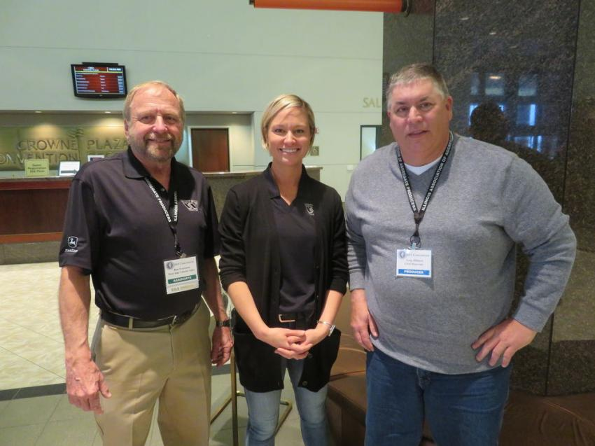 Ron Svartoein and Meghan Hargrave of West Side Tractor Sales Co. meet with Greg Hilliard of Civil Materials.