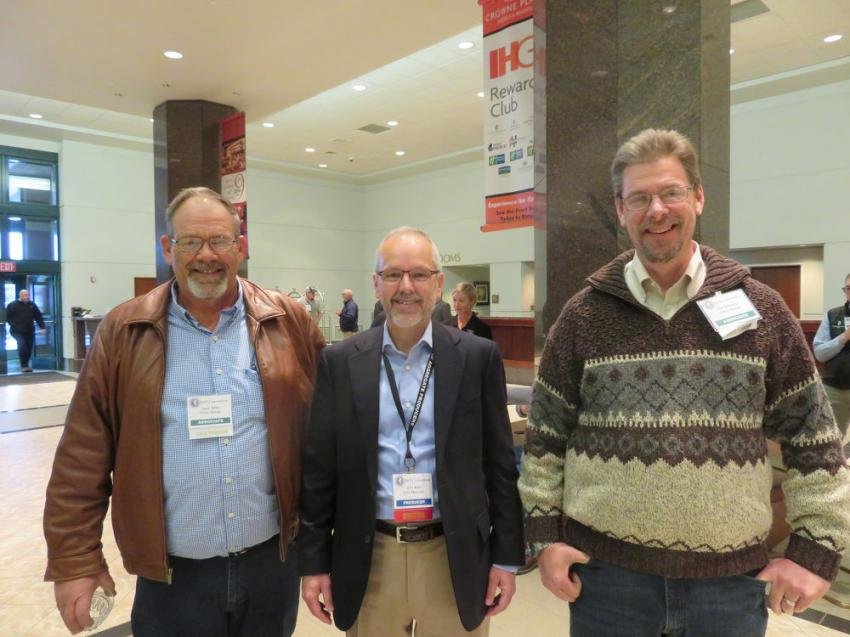 Eric Helm of Civil Materials (C) meets with Spud Miller (L) and Jim Deininger of Orica Mining.