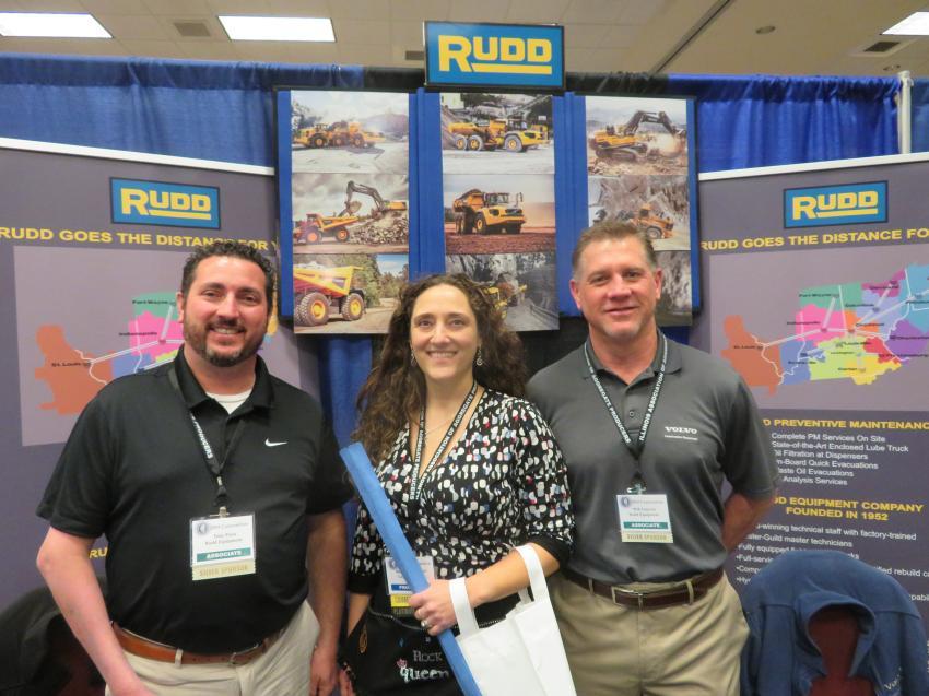 Becky Kazmierski (C) of LafargeHolcim says hello to Tony Pona (L) and Will Gmerek of Rudd Equipment.