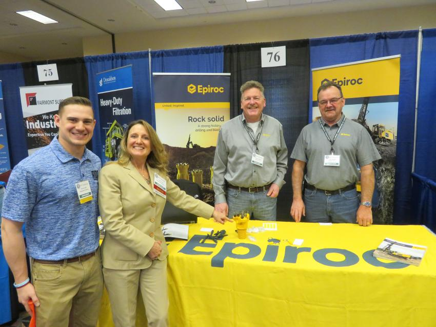 (L-R): Ryan and Ann Leslie of Raimonde Drilling stop by the Epiroc USA booth staffed by Sturges Taggart and Jeff Spritka.