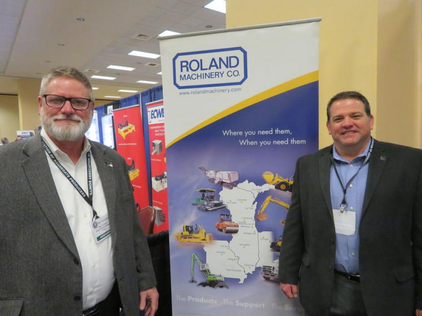Mike McCulloch (L) of Wirtgen Group and Kelly Graves of Roland Machinery Co.