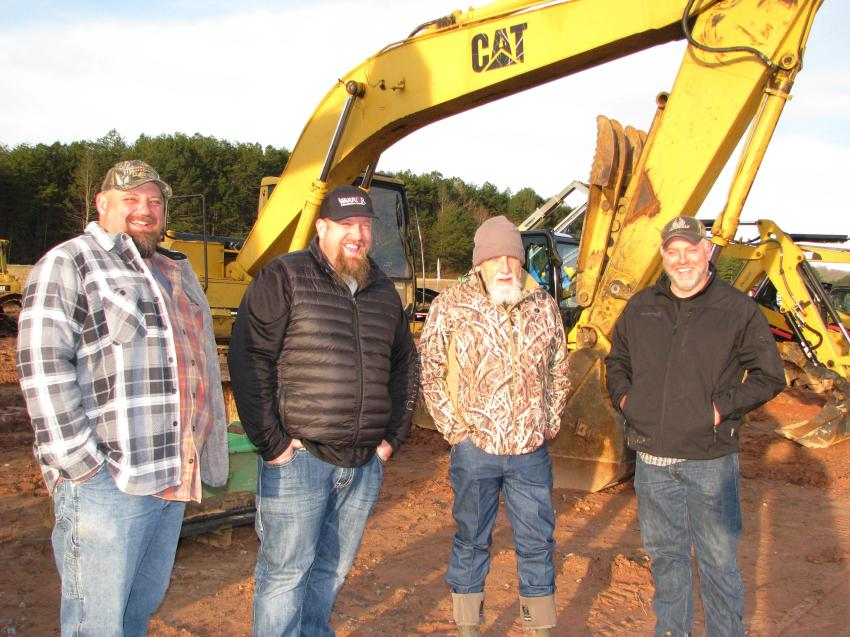 Enjoying a sunny north Georgia morning and talking about the machines in the sale lineup (L-R) are John Smith, Smith Excavating, Bryson City, N.C.; Brock Parker and Cat Parker of Warpaint Enterprises, Cherokee, N.C.; and Mike Shuler, Mike Shuler Excavating, Bryson City, N.C.