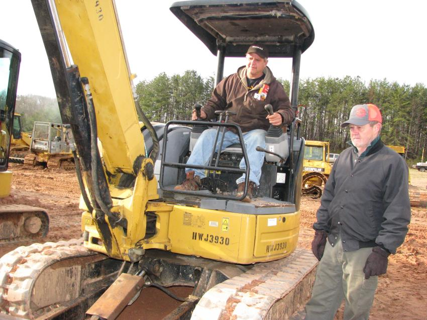 Test-operating a Cat 305C-CR mini-excavator are Donovan Phillips (L) of Phillips Grading, Boone, N.C., and Tom Wright of Wright Engines, Lenoir, N.C.