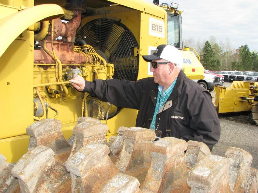 Wrapping up his inspection of a Cat 815 compactor is Ernest Pearson of The Blain Companies, Mount Olive, Miss.