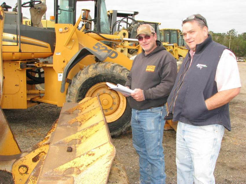 Bruce Holder (L) of BH Cattle, Collins, Miss., and Bernie Rogers of BR Cattle Company, also in Collins, were both interested in a pair of Case 521D wheel loaders for use in their farming operations.