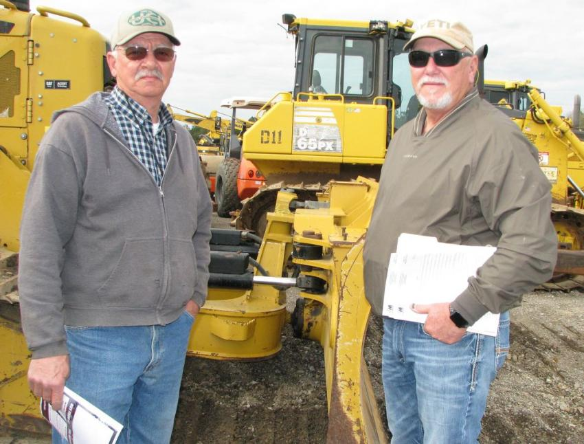 Jerry Ertle (L) and Mike Loflin, representatives of Utility Constructors, Jackson, Miss., were big consignors at the auction, with a fleet of dirt-moving equipment for sale.